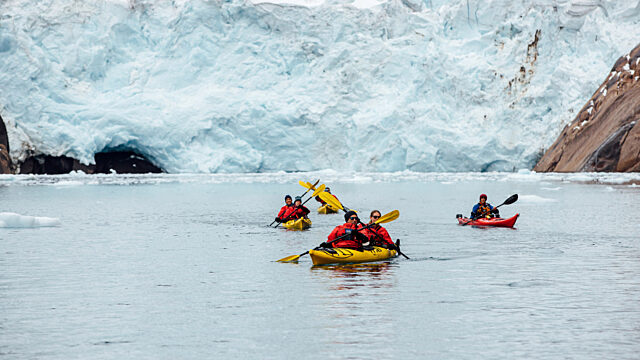 Kayakers in East Greenland