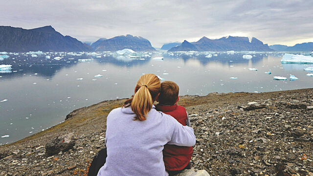 Mother and son Greenland fjords
