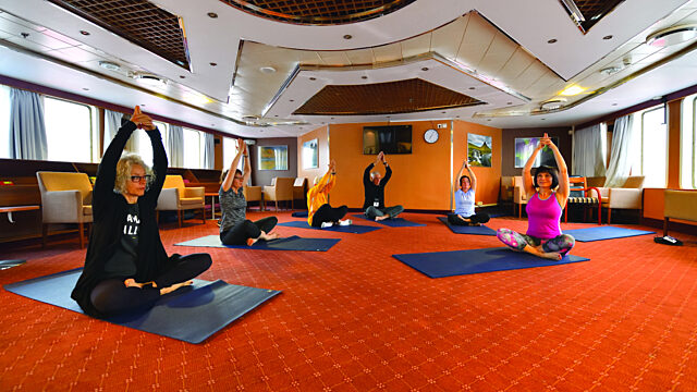 Onboard yoga stretching class