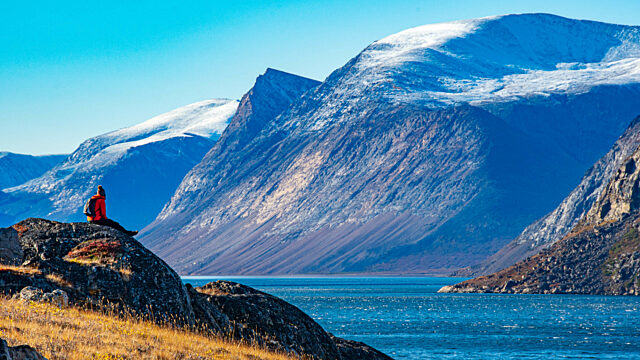 Traveller sitting Torngat Mountains