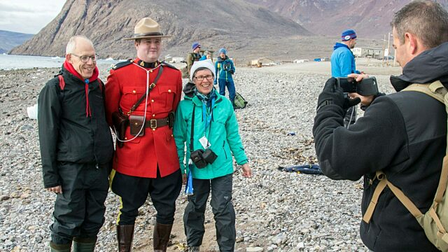 Don warnet and his wife carolyn posing for s photo with canadian mountie