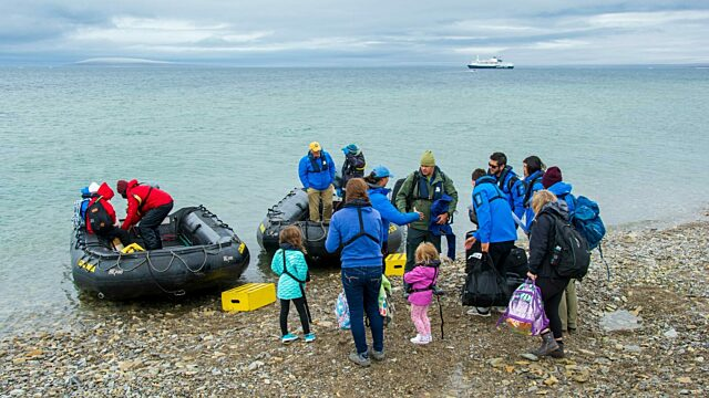 Travellers transfer from zodiacs to Ocean Endeavour Qausuittuq Resolute Bay