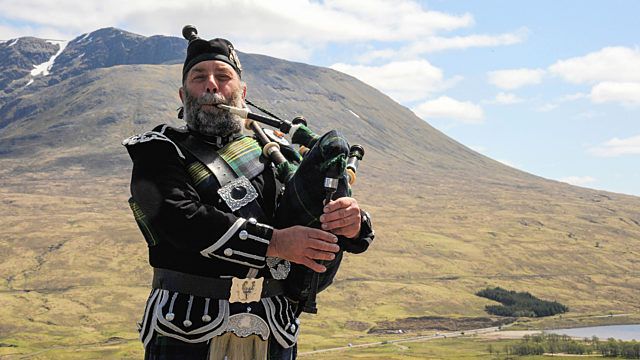 Highland Piper En Route To Glencoe