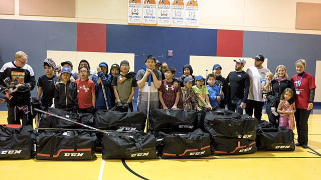 Kids Receiving Hockey Equipment Nunavik