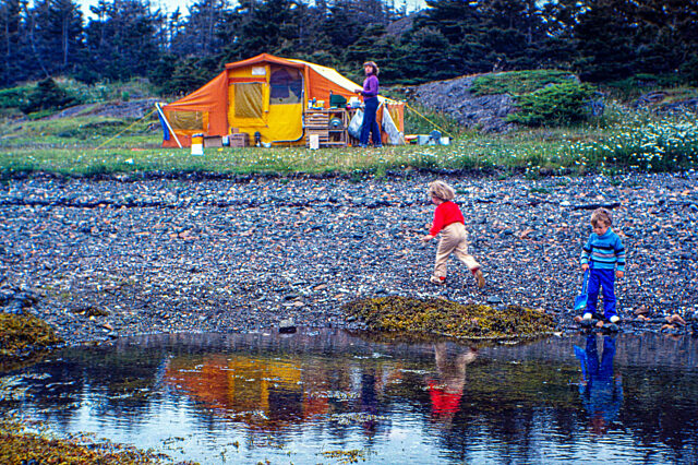 Children woman tent by water Newfoundland