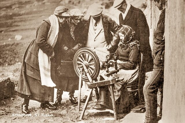 Historical photo people watch St Kilda woman spinning wool