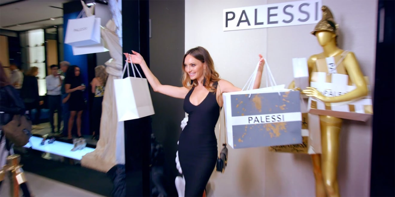 A woman holds Palessi bags.
