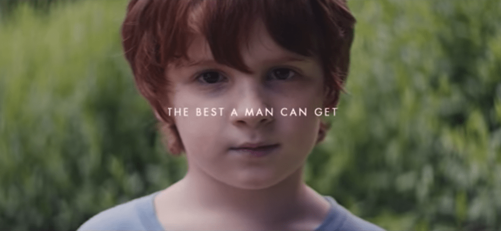 """Gillette's slogan """"The best a man can get"""" is shown with a child."""
