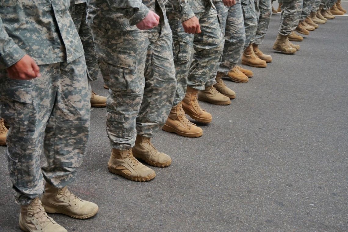 Solders stand in a line.
