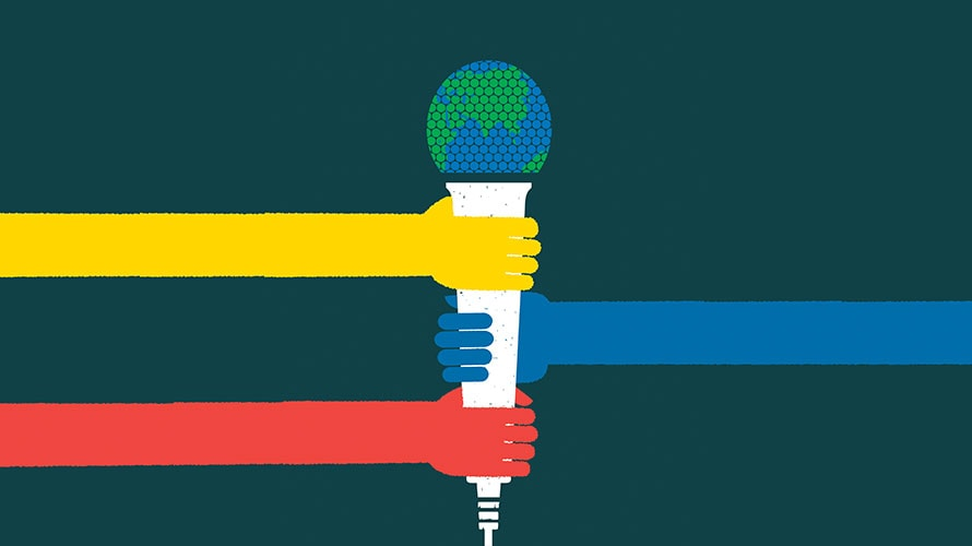 A microphone; the top is a globe; three hands hold onto the microphone; the hands are yellow, blue, red