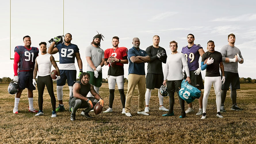 11 NFL players and one coach are posing for a Verizon campaign.