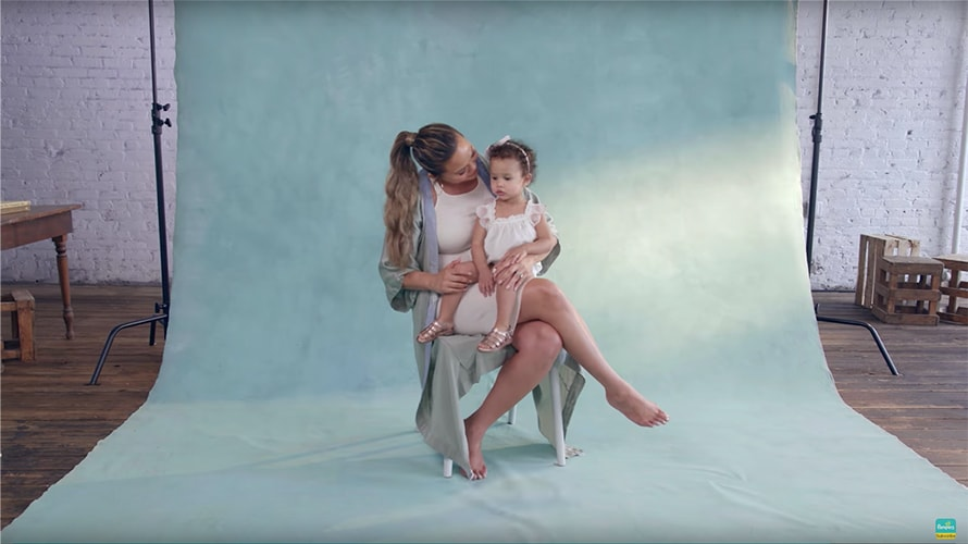 Chrissy Teigen communicates with her daughter as she is on the set for a Pampers advertisement