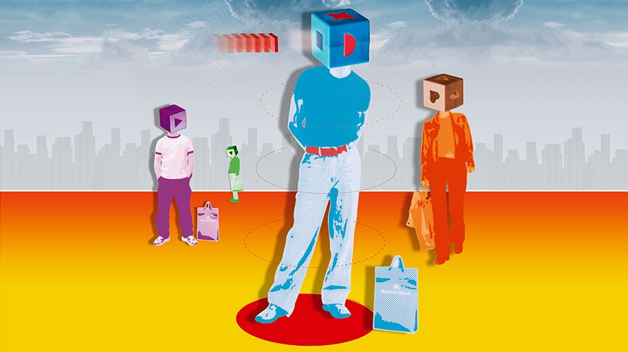 four people dressed in different colors; all the people have boxes on their heads