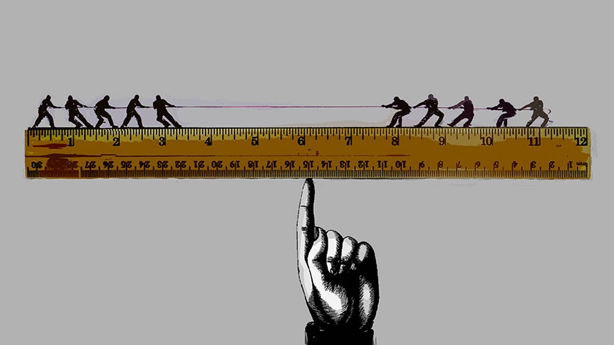 A giant hand extends its index finger; atop the finger balances a ruler; on top of the ruler two teams battle in tug-a-war