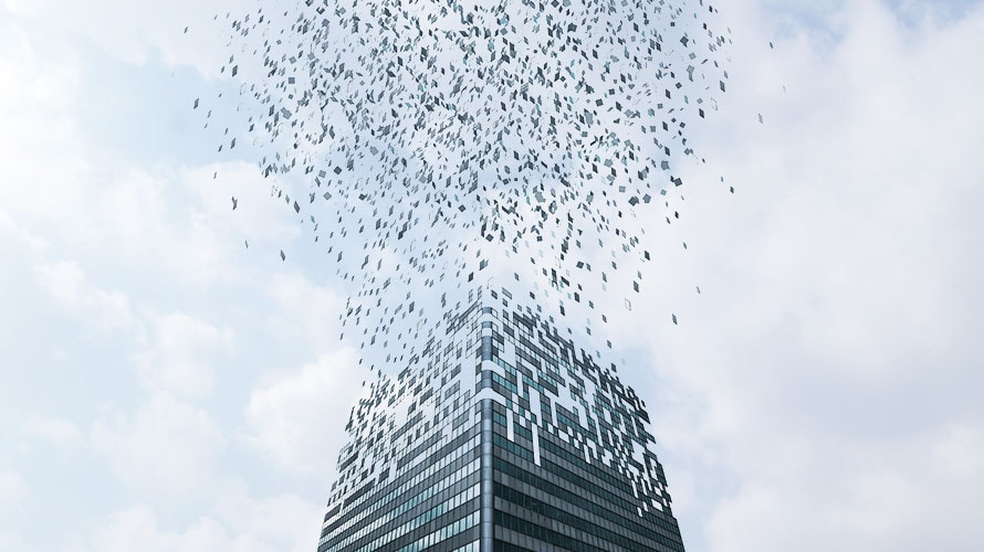 a skyscraper is turning into tons of pixels