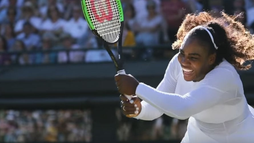 Serena Williams hits a tennis ball in a match