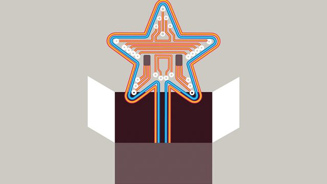 A orange and blue star coming out a cardboard box
