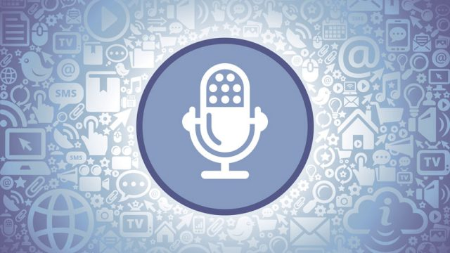 Based on a blue background; in a circle is a white microphone