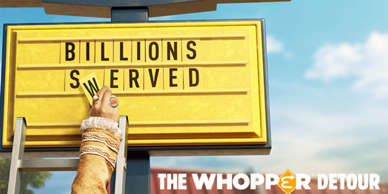 """Letters on a Burger King sign are being put up; The sign says, """"Billions Served;"""" In the bottom a title says """"The Whopper Detour"""