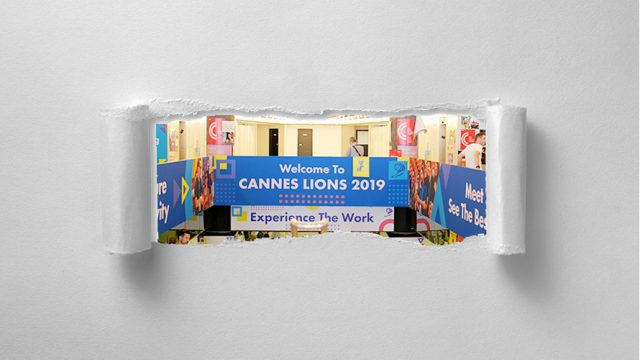 A unrolled scroll; A welcome sign to Cannes Lions on the scroll