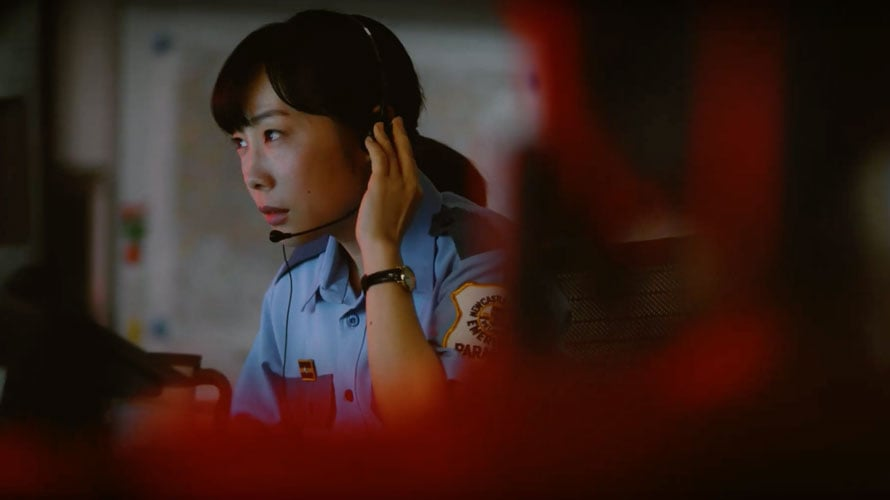 911 operator in a still from Jo Motoyo