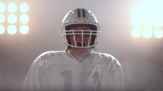 The Tonight Show's Jimmy Fallon in football gear screaming