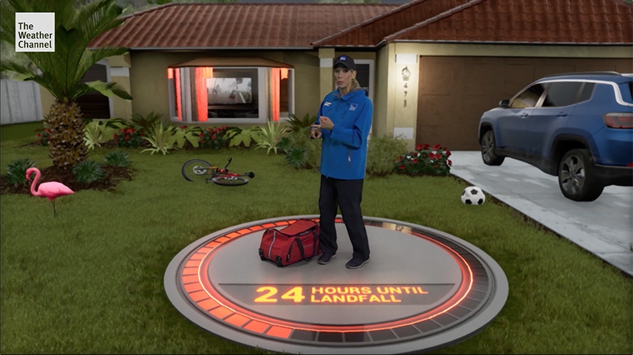 Weather Channel meteorologist Stephanie Abrams uses a State Farm bag and stands in front of a house during a Weather Channel immersive mixed reality segment about Hurricane Dorian.