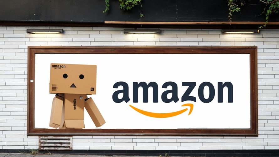 Billboard with amazon robot made out of amazon boxes and amazon logo