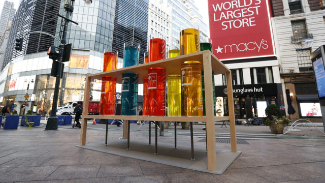 Colorful liquid in giant test tubes are on display in New York's Herald Square