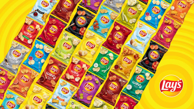 Multiple bags of Lay's potato chips in various flavors