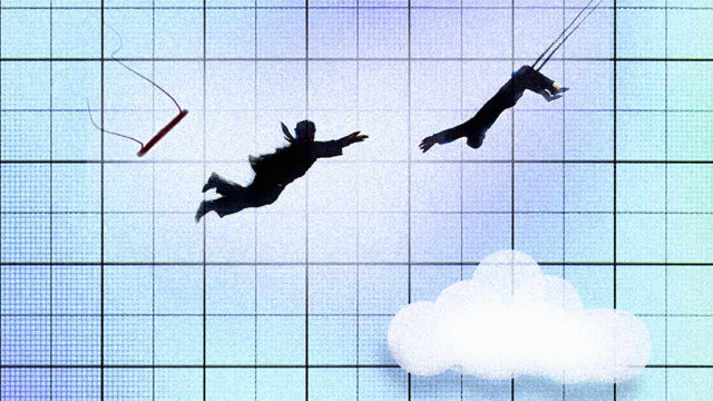 Businessman swinging on trapeze catching colleague mid-air