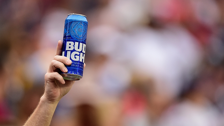 Hand holding up can of Bud Light