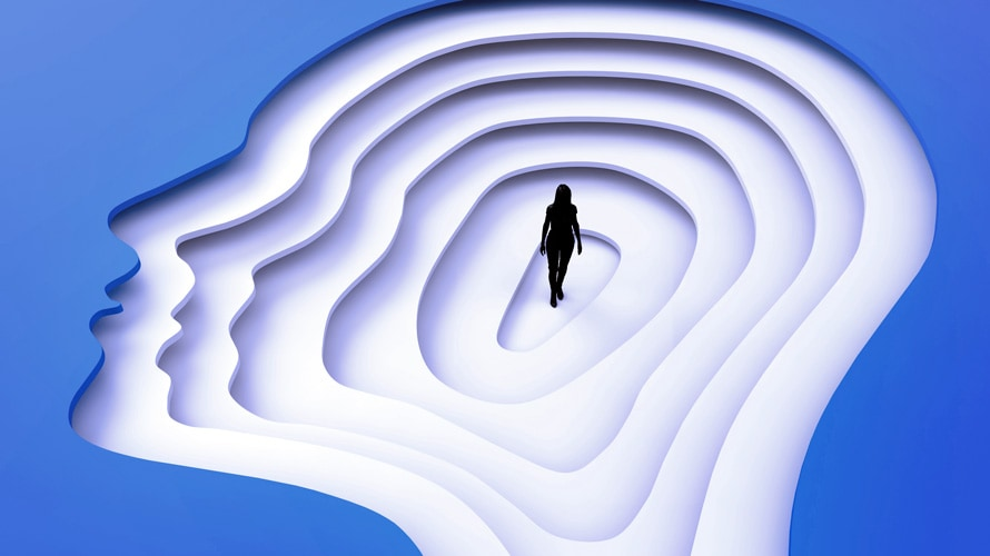 Silhouette of a woman inside stacks of head cut outs