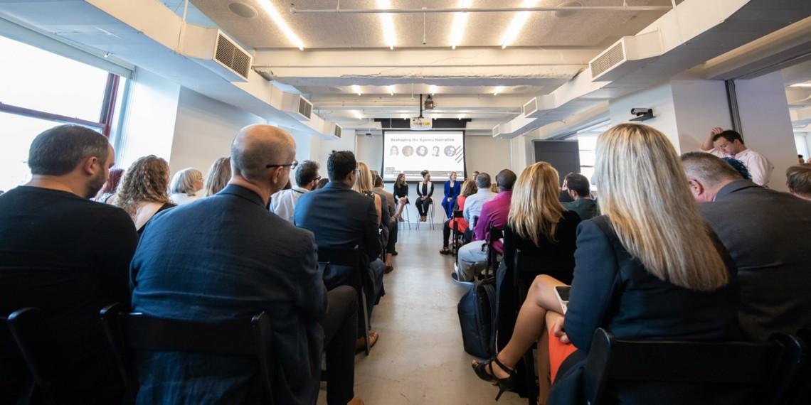 audience members listen to speakers at Adweek
