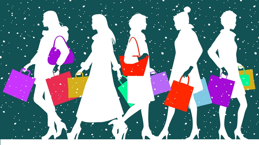 Five different women walking with shopping bags