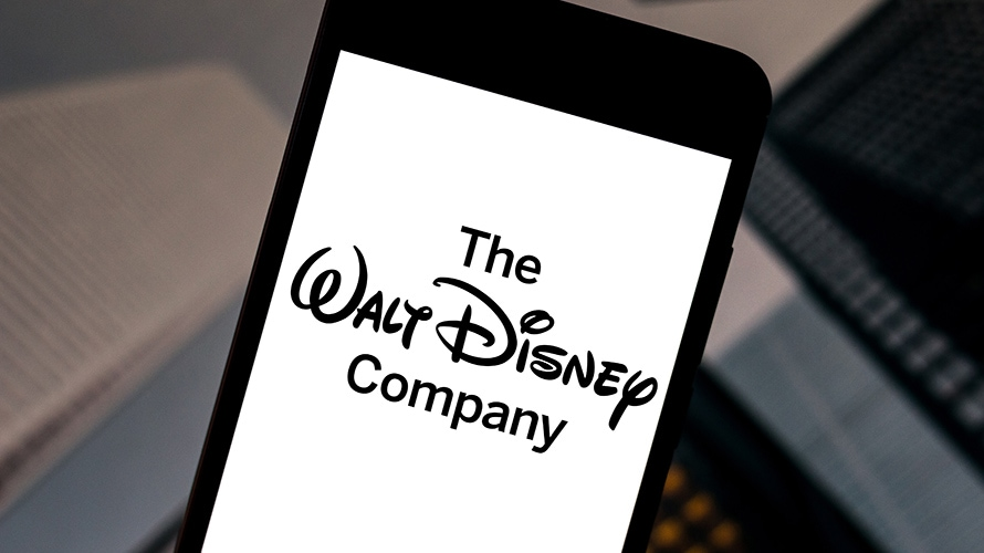 """A smartphone with a screen open that says """"The Walt Disney Company"""""""