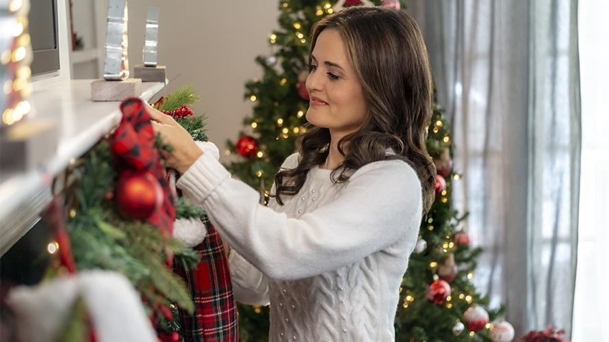 Actress Danica McKellar setting up Christmas decorations