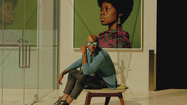 Swizz Beatz with art in his home