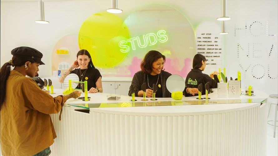 Studs store with employees and customers