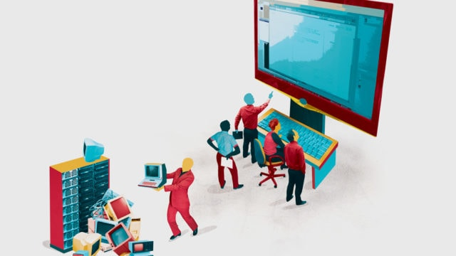 4 business people working at a huge computer while one puts away old computers