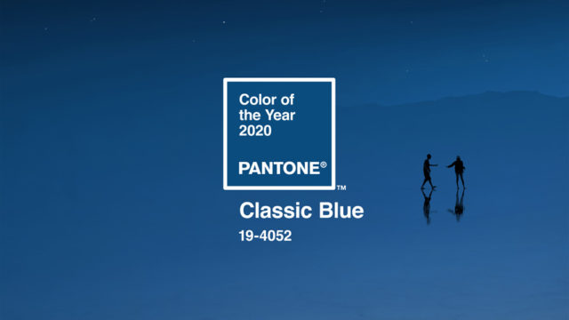 "An image of two people in the distance with text that says ""Color of the Year 2020,"" ""Pantone"" and ""Classic Blue 19-4052"""