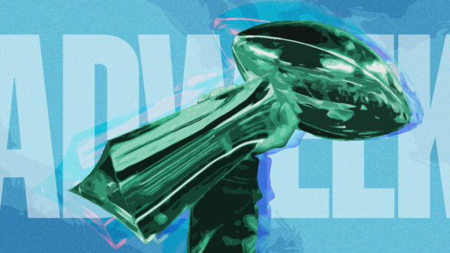 Hand holding the Vince Lombardi Trophy