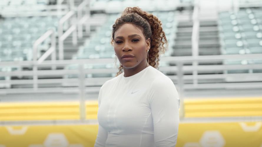 serena williams standing in an empty stadium
