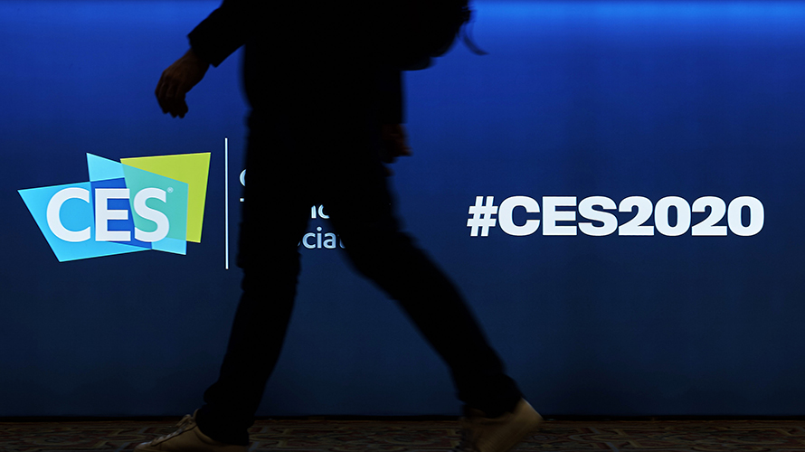 CES logo with a silhoutted person in front