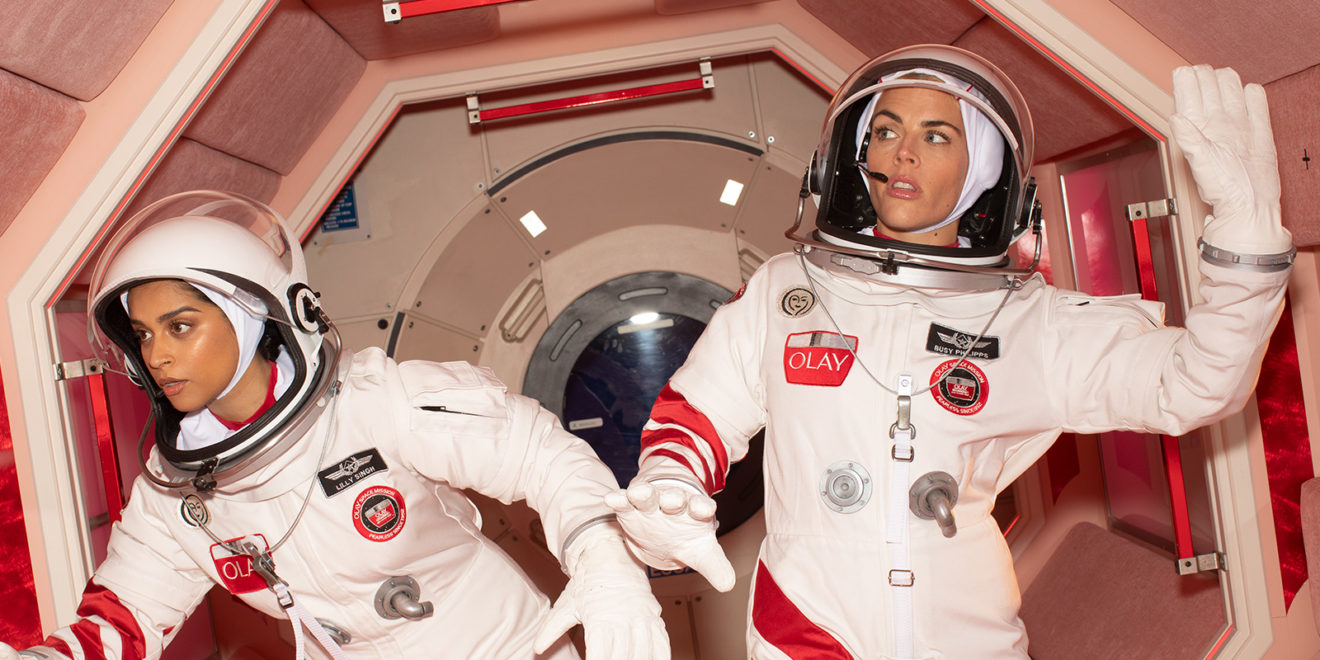 Taraji P. Henson and Lilly Singh in spacesuits in Olay ad