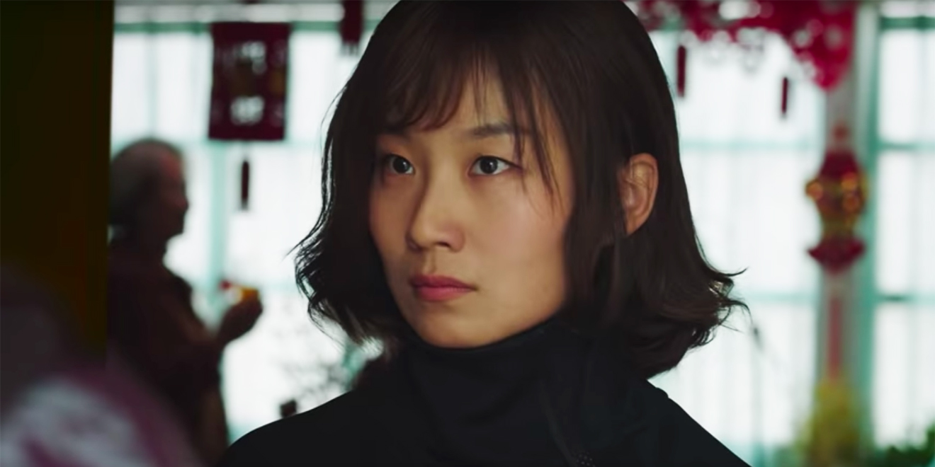 Still of a woman with a black turtleneck