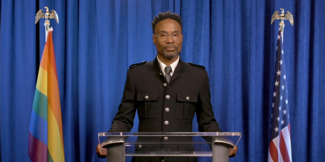 billy porter standing at a podium
