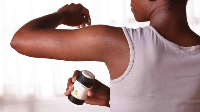 a person using deodorant