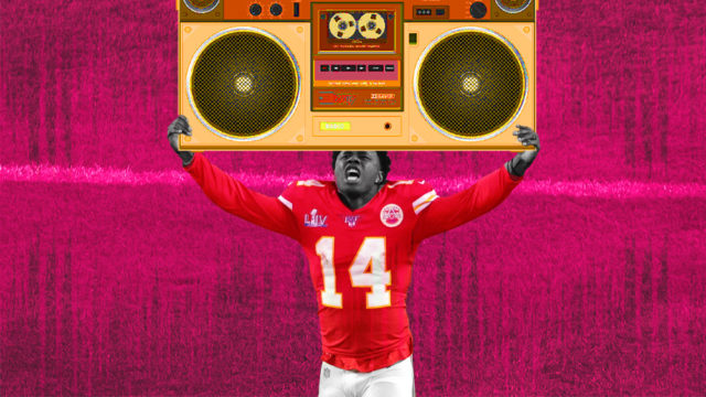 a football player in a red no. 14 jersey with a boombox on his head