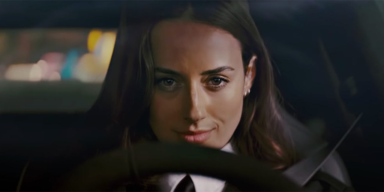 a woman sitting at the steering wheel of a car